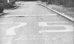 The famed '75' painted on the high school driveway by parties unknown. The responsible party may now own up because th
